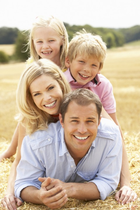 Family Smiles in Field